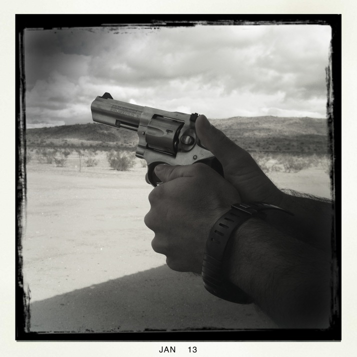 "A friendly neighbor of friends in Ajo shows me the proper grip on my pistol. He spends his workdays or work nights on horse patrol in the southern Arizona desert, with all kinds of digital assists mounted on his gun, his helmet, his pony, seeking ""stuff"" in the desert."