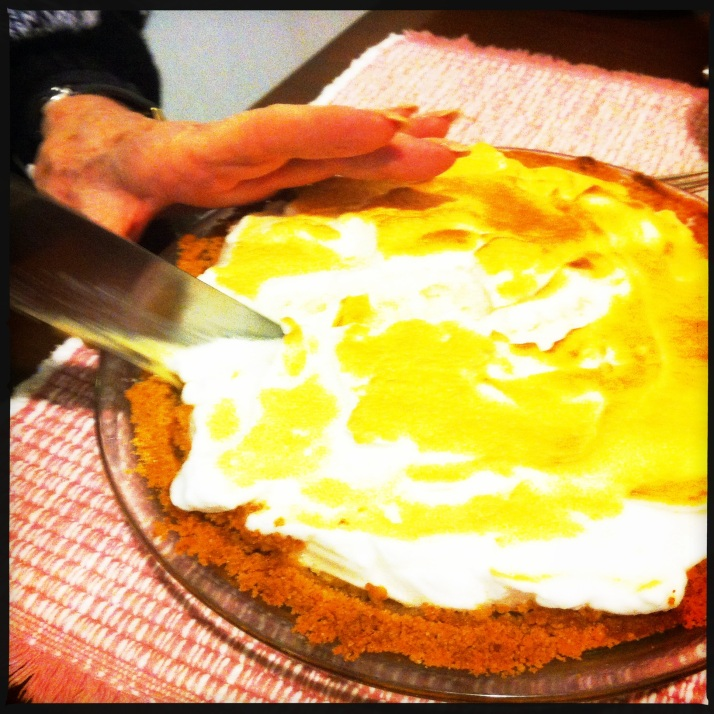 Auntie cuts her homemade key lime pie