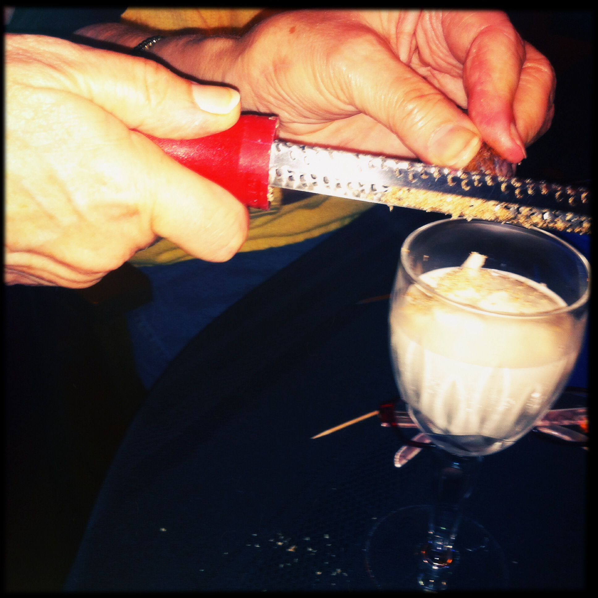 Connie grates nutmeg onto homemade Brandy Alexander