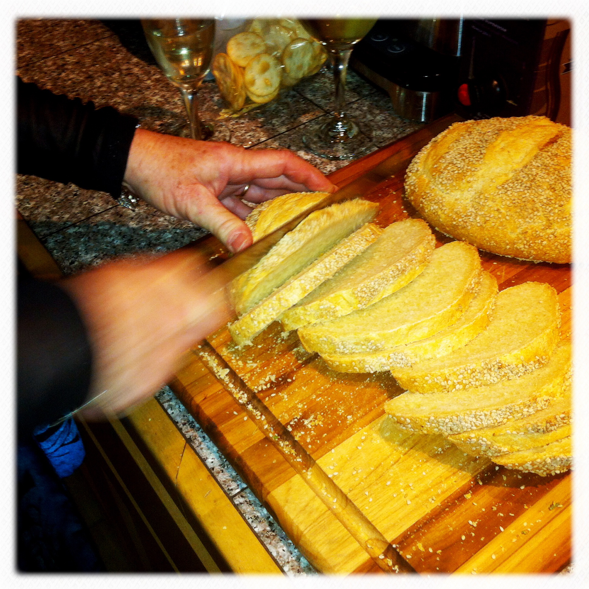 Cynthia slices homemade sourdough