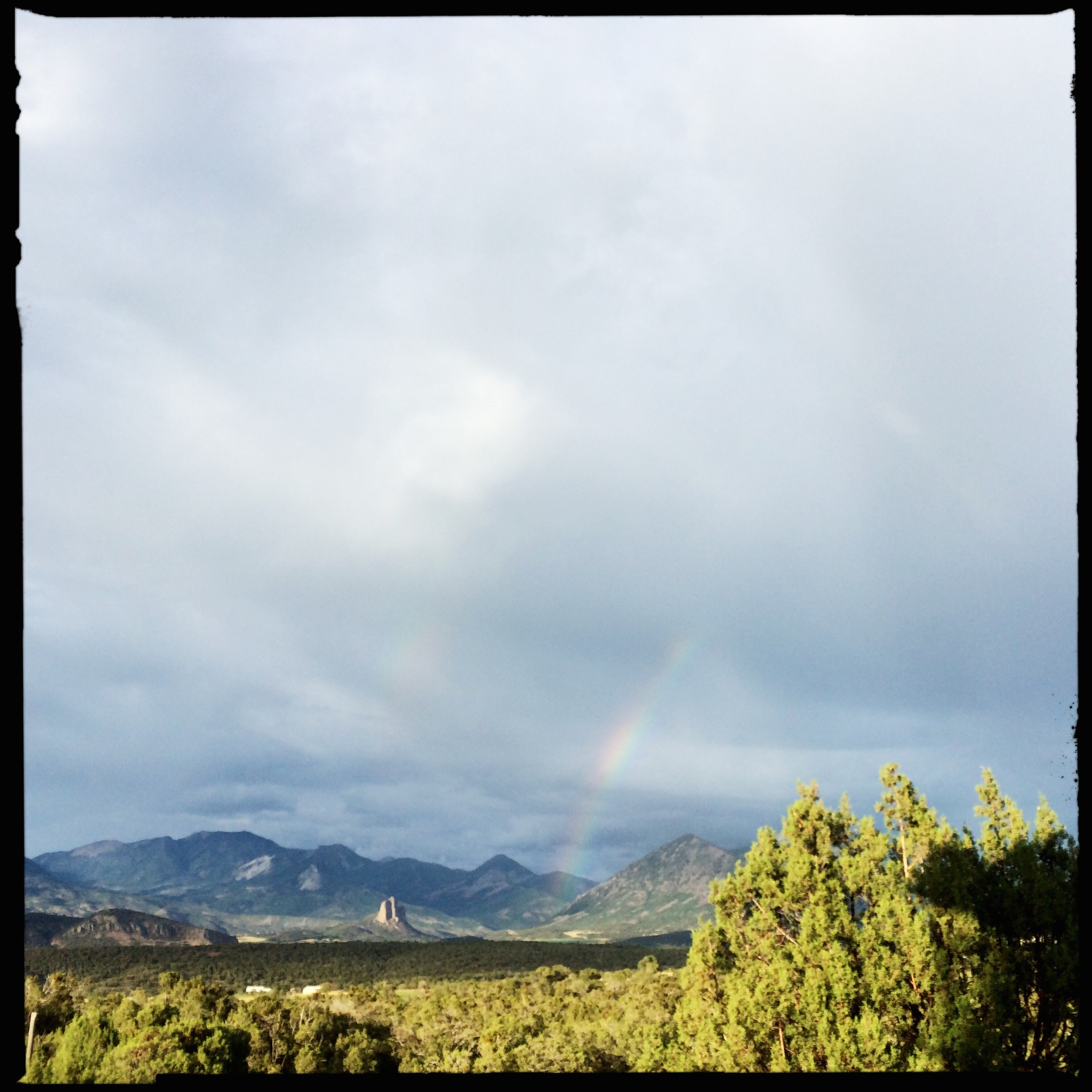 As I finished the over-toasted, under-tomatoed BLT, the sky gave up another rainbow.