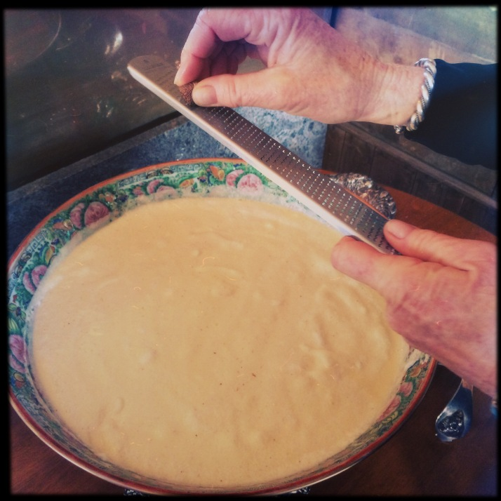 Pamela grating nutmeg on farm fresh eggnog in the ancestral Cantonese punchbowl.