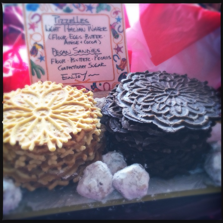 Delectable handmade Pizzelles, with a garnis of pecan sandies.